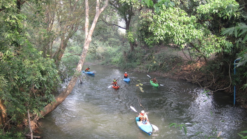 People kayaking on the Ping River