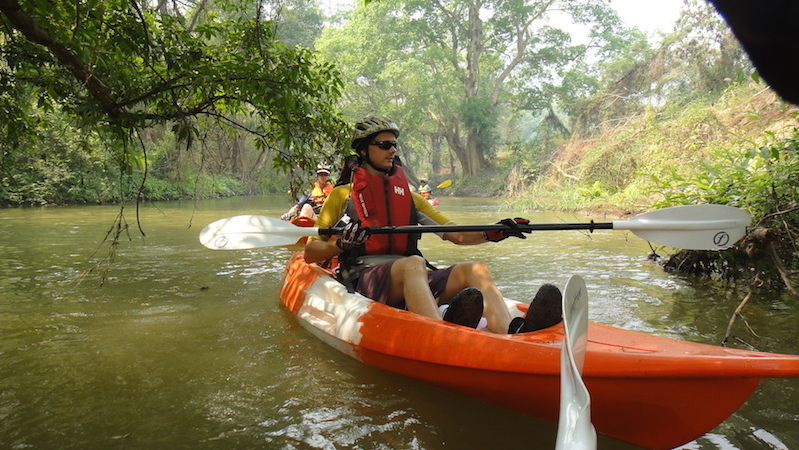 guest enjoying kayaking on the Ping River