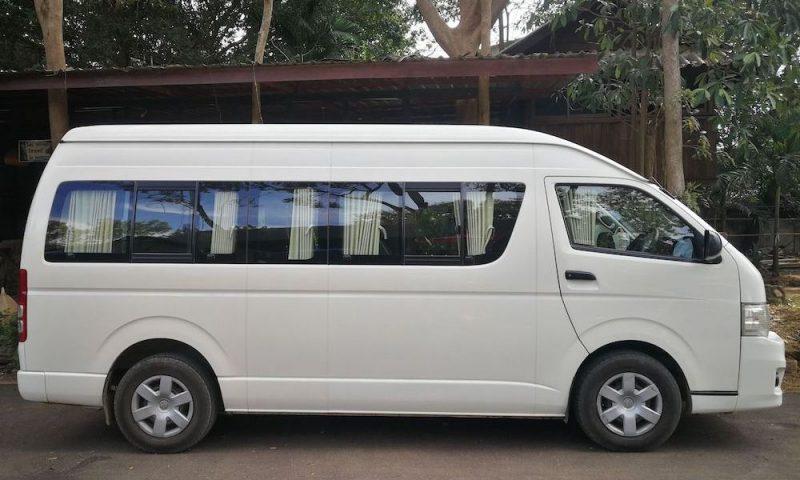 White minibus Green Trails transportation