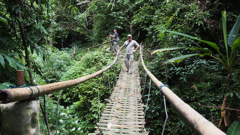 Mae Lai trekking guest on bamboo bridge