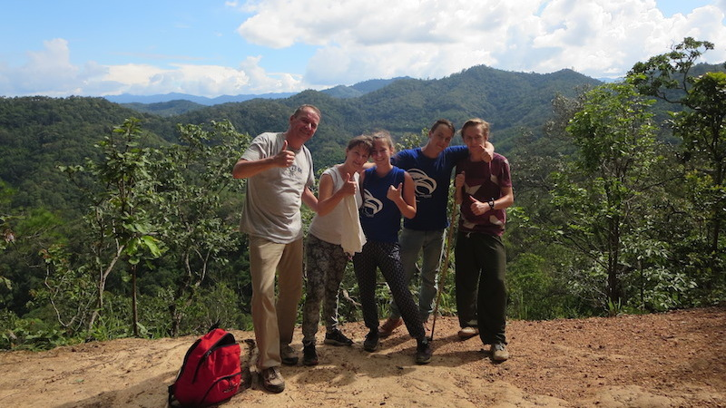 group of guests with view in the background Chiang Mai hill tribe trekking