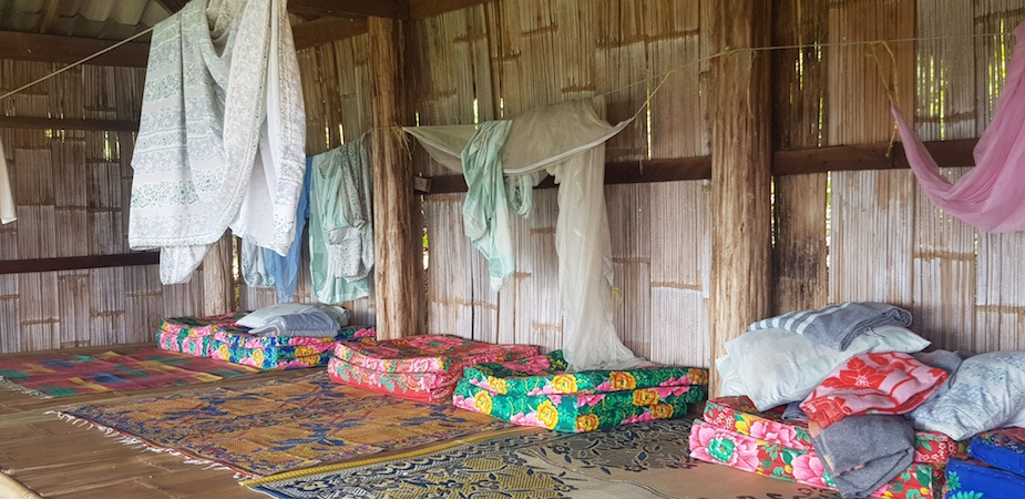 Mosquitonets and mattresses at homestay