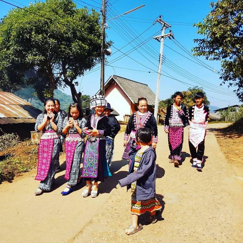 Hmong women walking to the New Years festivities at Baan Mae Sa Mai Hmong Hill tribe