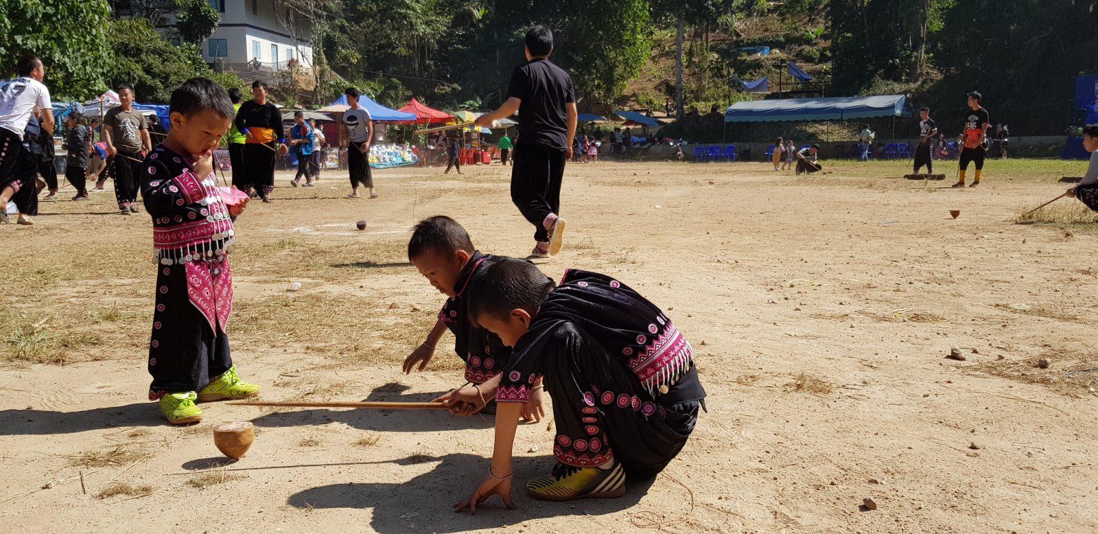 Hmong New Year. Boys playing a game at Ban Mae Sa Mai