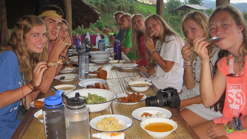 Student enjoying dinner on Educational Treks