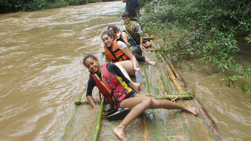 Four kids on a raft on the Taeng River