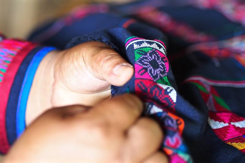 Hand knitting of Akha textiles