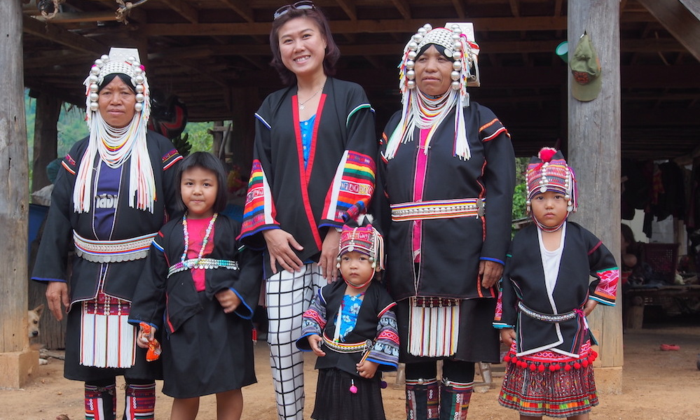 Five Akha people with tourist