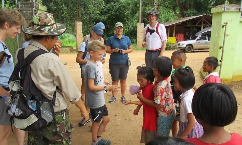Interaction with local kids family trekking