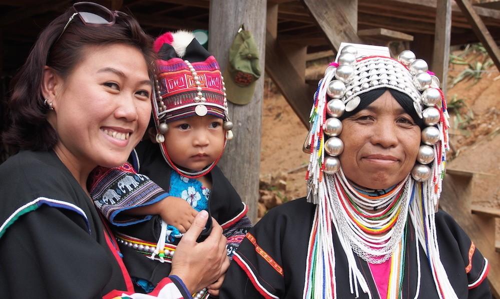 Akha woman, child and tourist