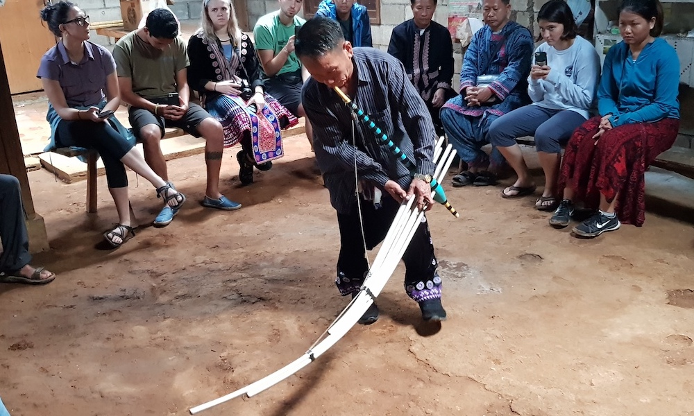 Ban Mae Sa Mai Hmong Village musician performing for tourists