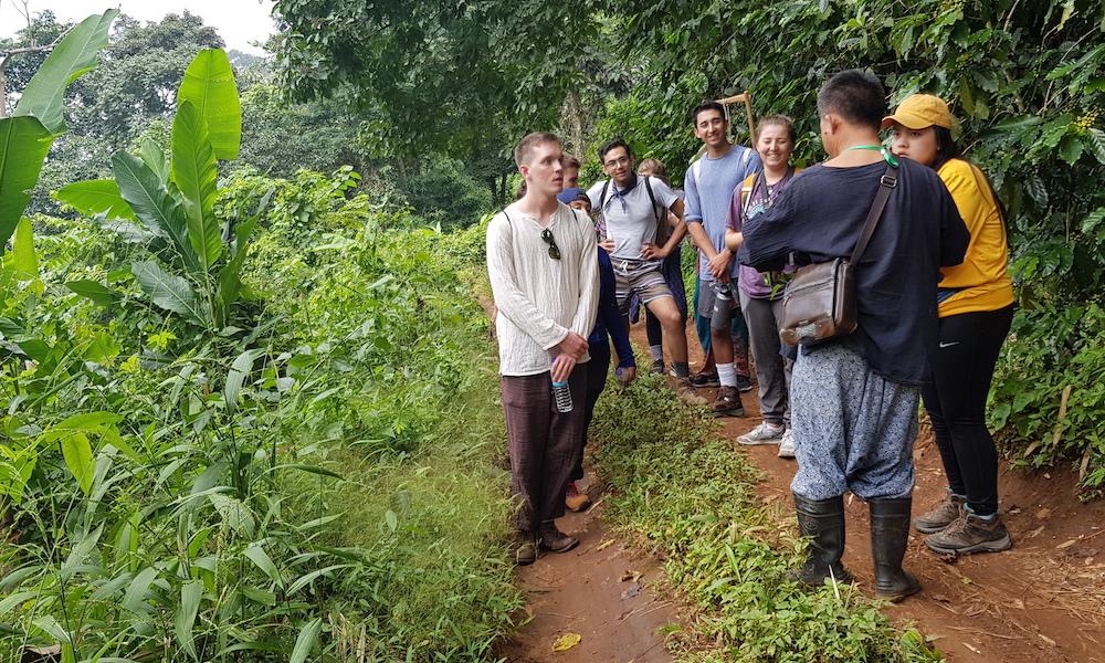 Guide with tourists Hmong village Ban Mae Sa Mai