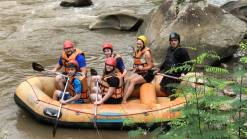 Tourists doing Whitewater rafting