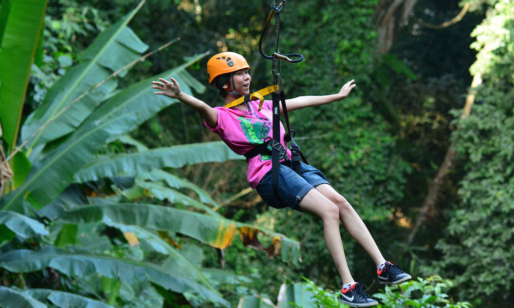 Female tourist Flying zipline