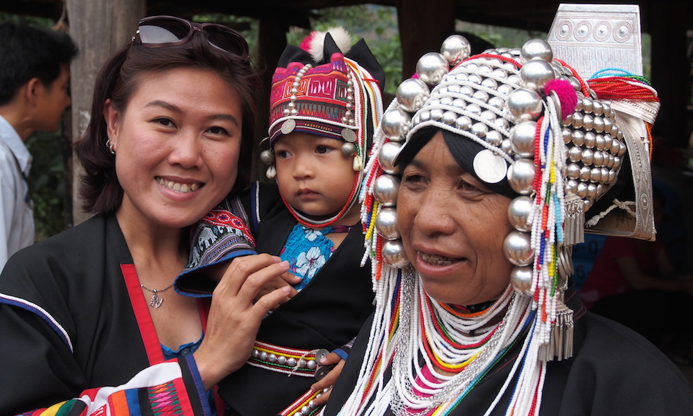 Akha woman and child and Asian tourist
