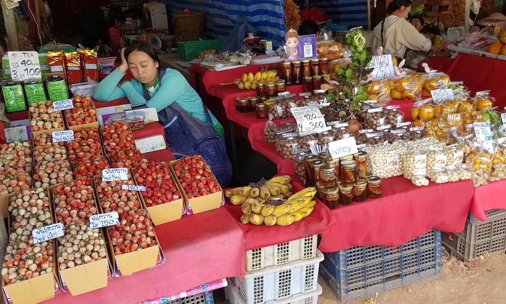 Woman sleeping Doi Inthanon Hmong Market