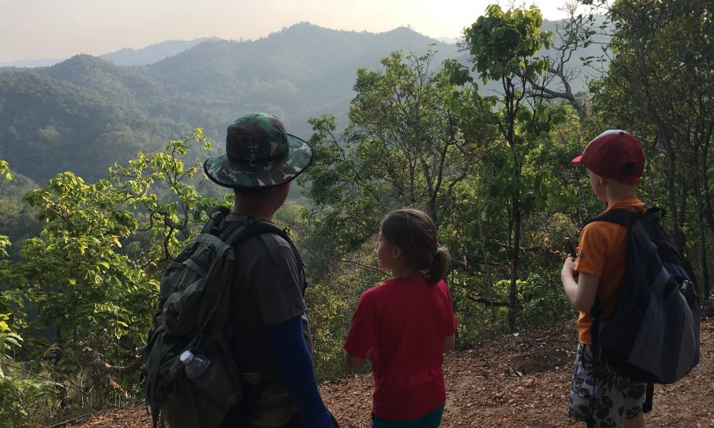 guide and kids Family trekking view