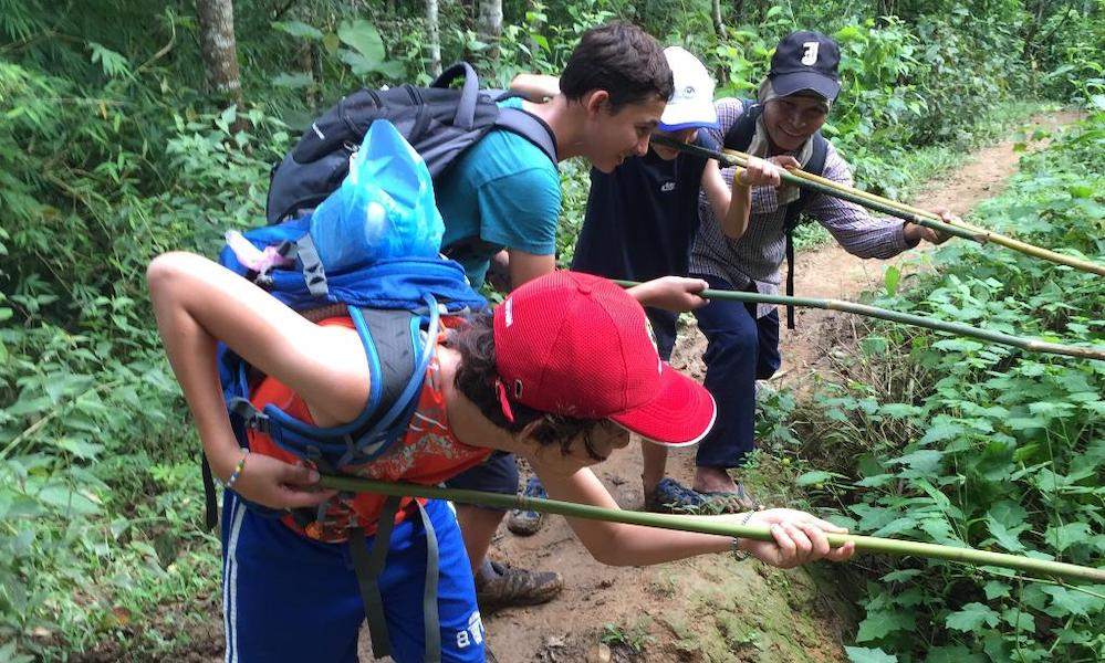 Guide and kids Fun during family trekking