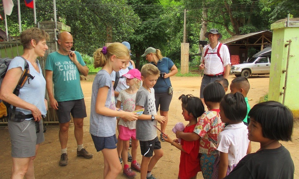Family trekking sharing with local children Chiang Dao