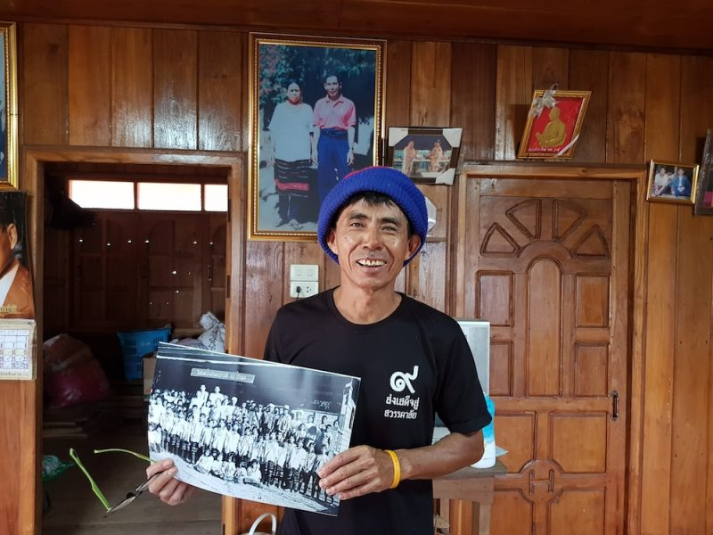 Sawaeng showing a picture of his parents, Ban Dong