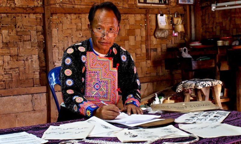 Sowmee on his working table Ban Mae Sa Mai
