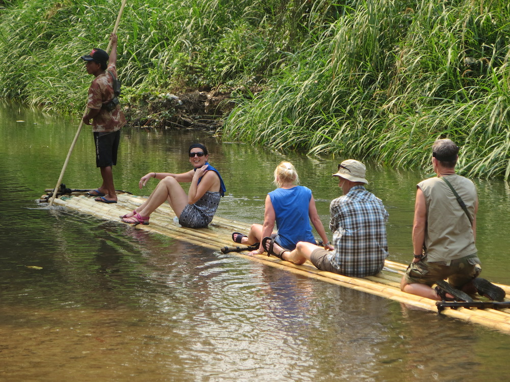 People sitting on a bamboo raft