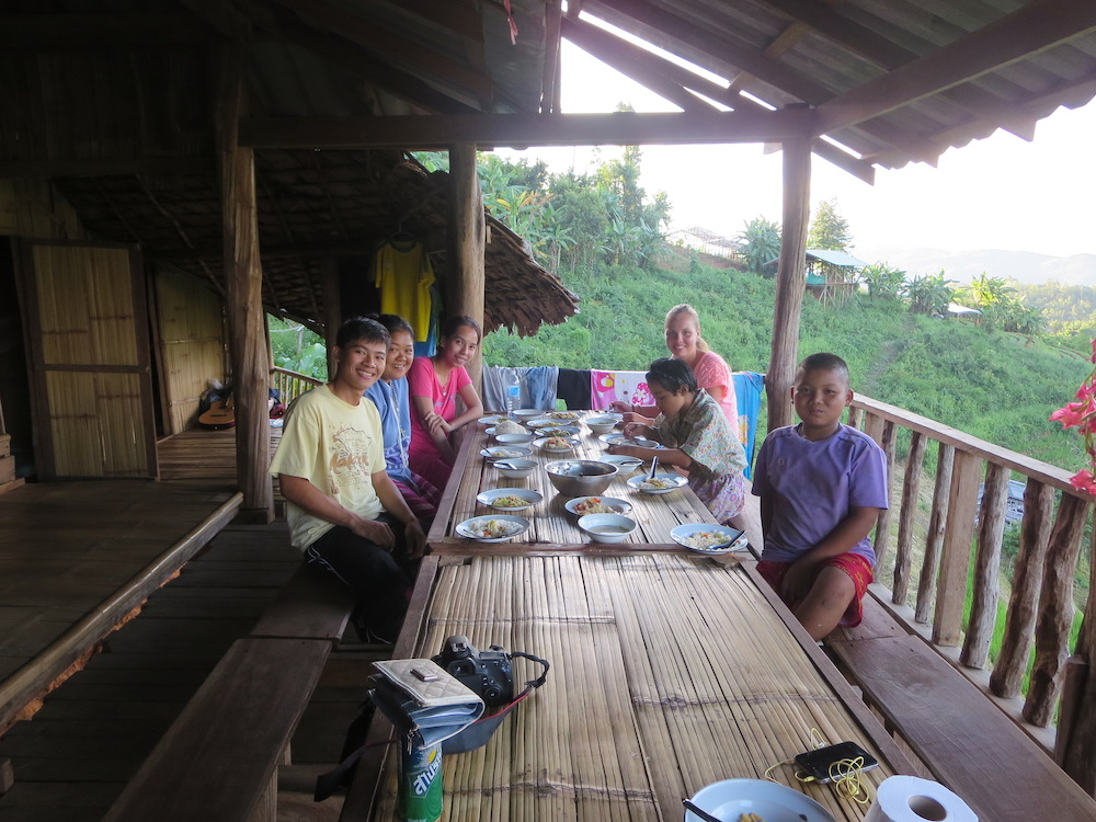 group sitting at a bamboo table
