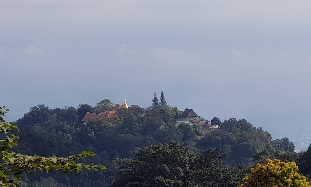 Golden chedi and temple aerial view