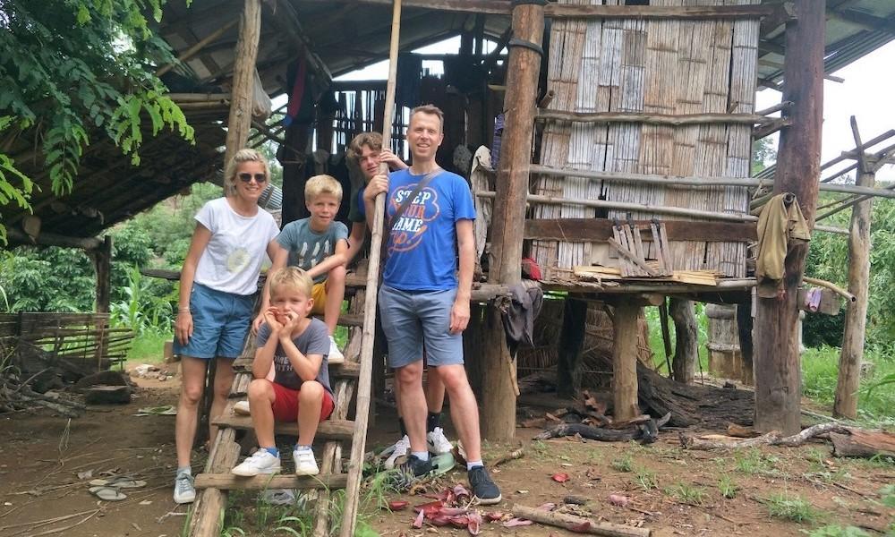 Family of three trekking in a village