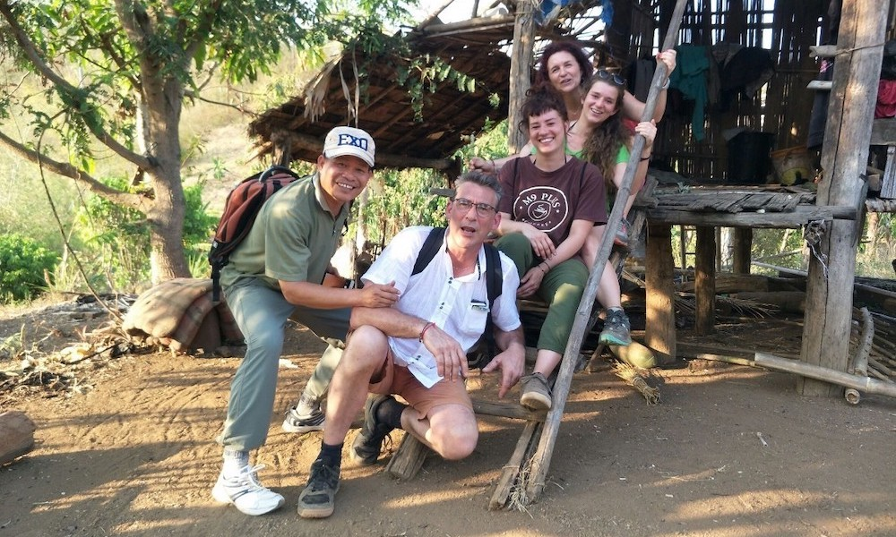 Thai Guide joking with trekkers in a village