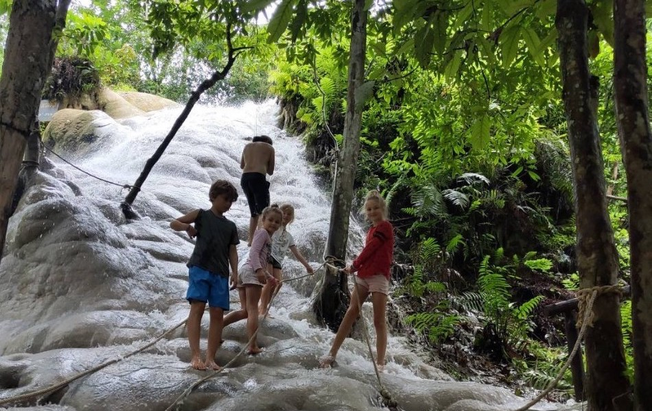 Four kids on Sticky waterfall