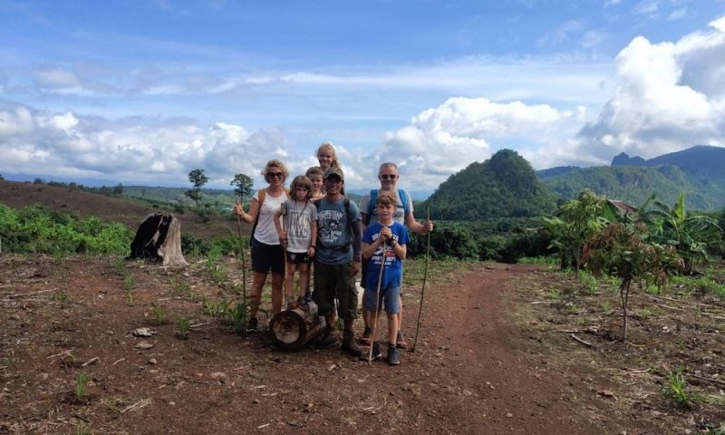Family of six with guide
