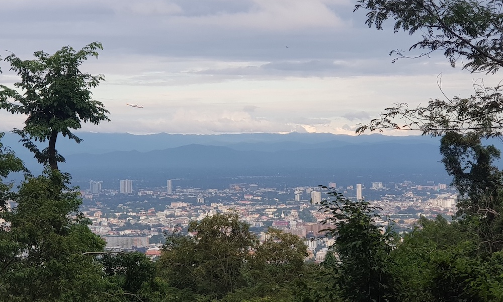 Sunset view of Chiang Mai with forest Doi Suthep Trail