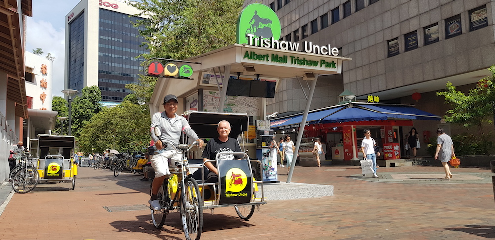 Trishaw with tourist in Singapore