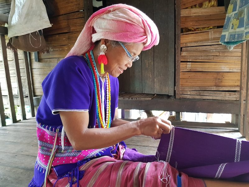 Woman knitting textiles