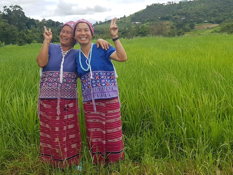 Two women in ricefield Mae Wang