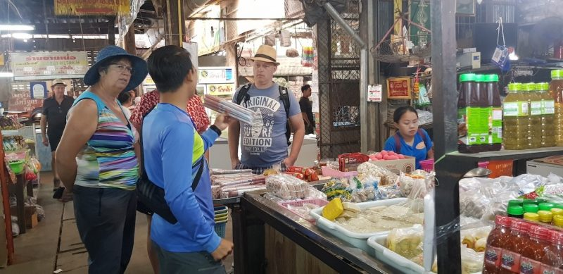 Guide with tourists at a local market