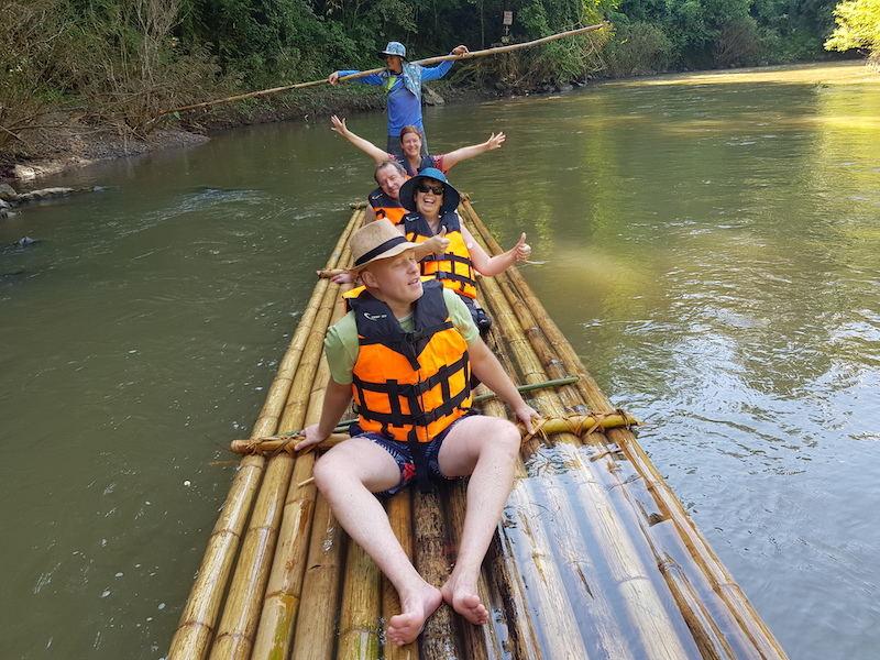 Tourists on a bamboo raft on a river