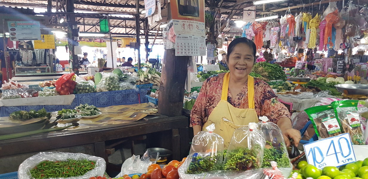woman at a market with fruit