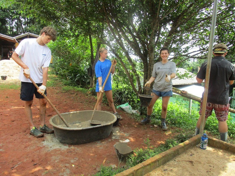 Four students at work in a village