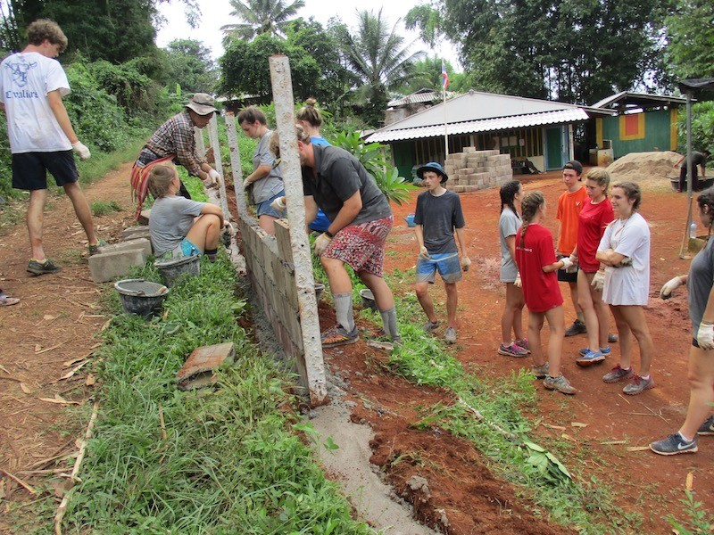 Student group constructing a wall