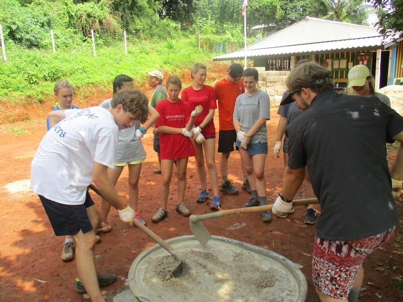 Young people mixing concrete