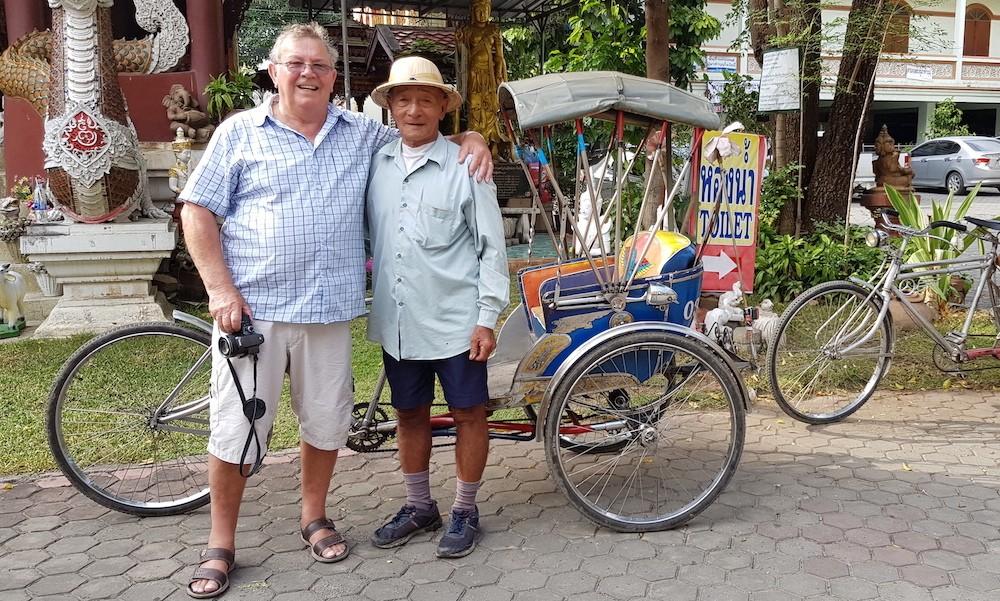 Tourist with samlor driver