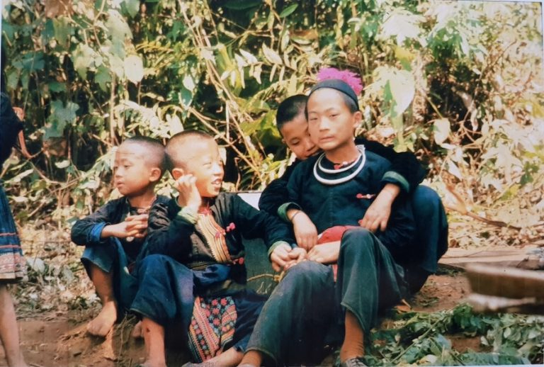 Four children in traditional dress