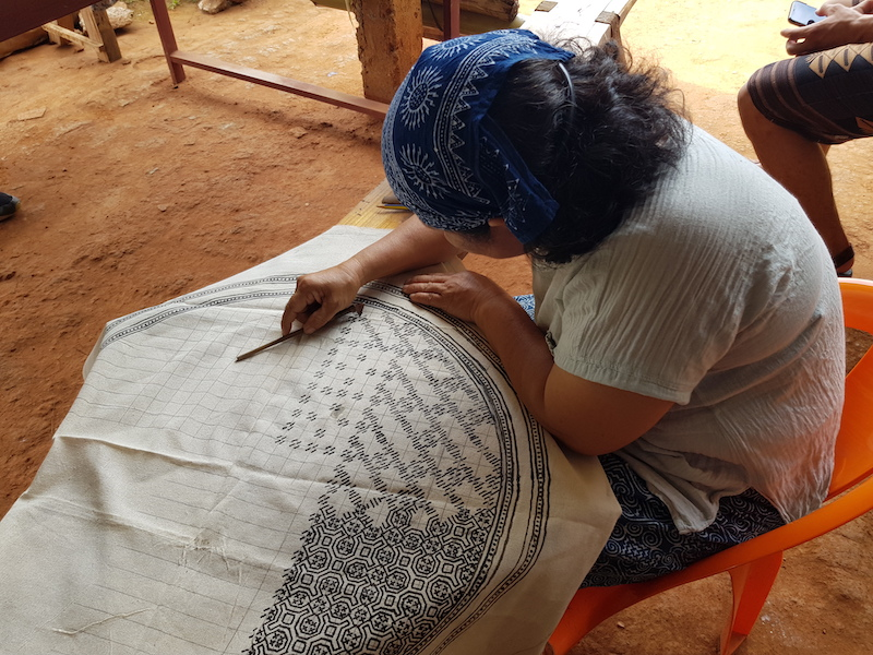 Woman doing tribal batik
