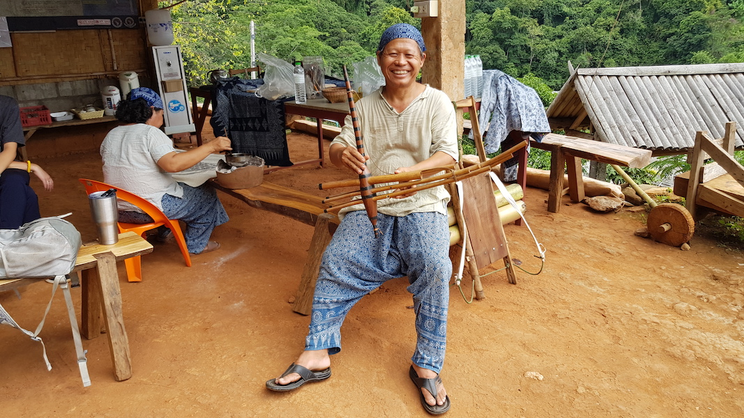 Local guide with musical instrument