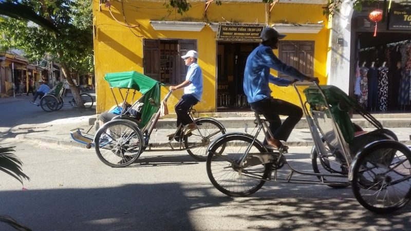 Two bicycle taxis in an old town