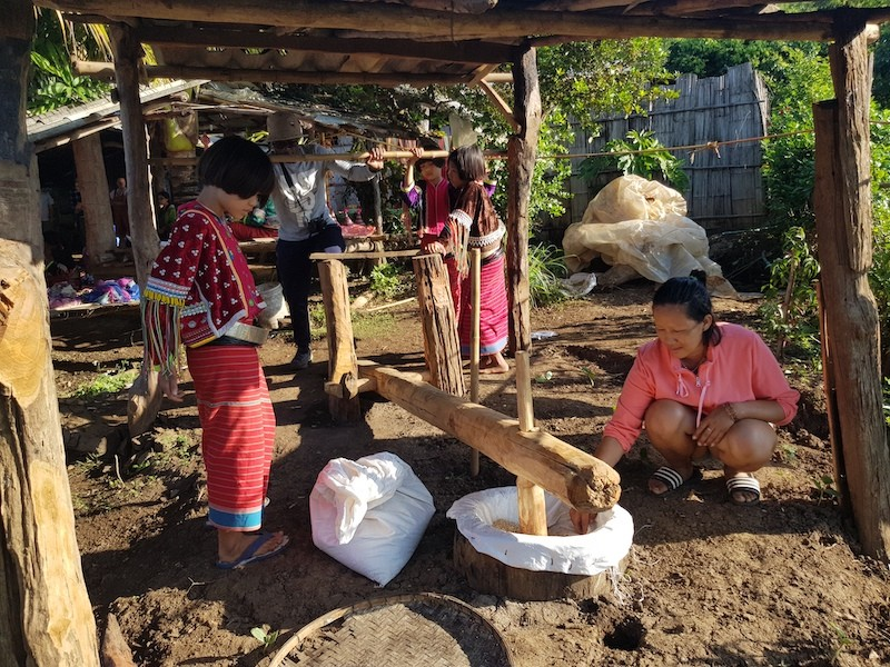 Local people with wooden pounder