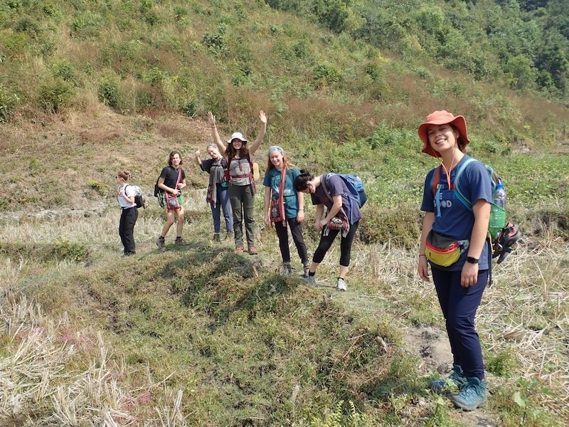 Young trekkers in a dry ricefield