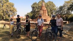Cyclist in front of ruin Chiang Mai educational tour